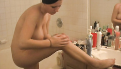Naked girlfriend puts lotion on her body