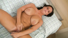 Young brunette toys her wet pussy with a glass dildo
