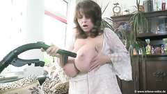 Busty MILF Cleaning around the house