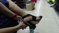 Girl in Stockings Walks around the Store Show Feet Foot under the Skirt