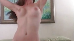Busty amateur brunette Holly loves playing her tits and puss