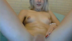 Barely legal blonde with small tits is gently rubbing her pussy in front of her web cam