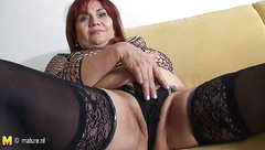 51yo housewife Emilia gets naughty on the couch