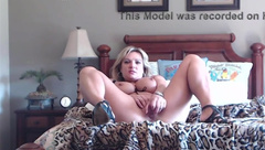 Sexy blonde cougar with hot implants and sultry voice