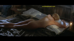 Charlize Theron lying naked on bed in The Cider House Rules