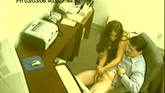 Chick gives great handjob in the office