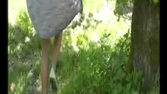 Naked walk in the park - skinny teen outside
