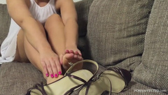 Feet and high heel sandals shoeplay