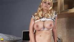 Blonde housewife playing with her natural big tits