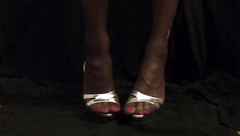 My feet in brown nylons and Heels