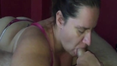 Chubby wife preforming a sucking ritual on a white prick