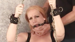 Blonde MILF Tori chained to the ceiling