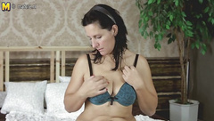 Horny mother playing with her toy on her bed