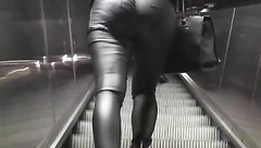 Candid ass in tight leather pants