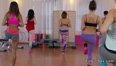 Three hot lesbians vibrating at the gym