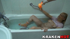 Krakenhot - Funny scene of a girl in the bath with her toy