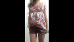 Camgirl removes her shorts