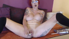 Busty red milf pounds her tattooed ass