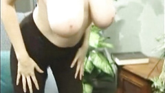 Busty Kathryn strips and playing her titties