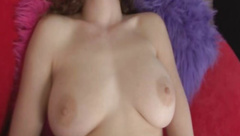 Curly haired girl with busty body masturbates