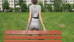 German girl in public is touching her tight leggings
