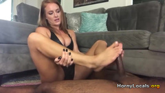 Fit white girl gives amazing BBC footjob