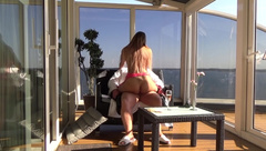 Prostitute fantasy on the executive suite's balcony at the Baltic Sea