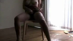 Cumming on the chair