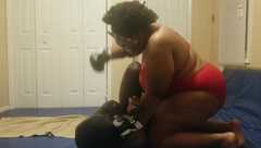 Mistress beats and pees on slave while wrestling